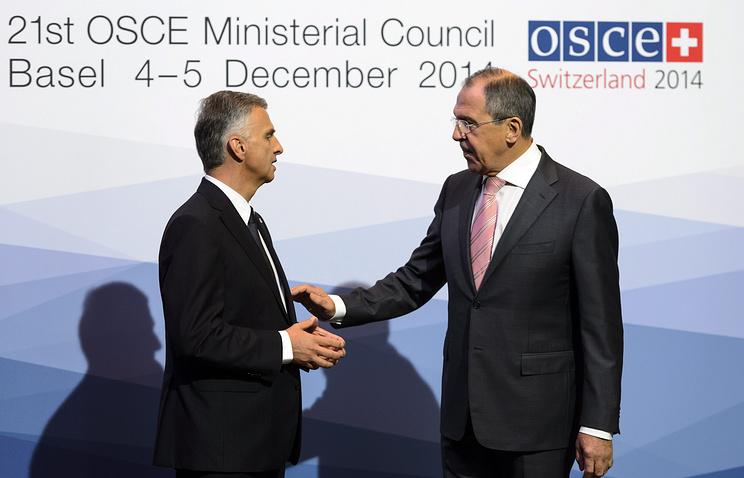 Swiss Federal Councillor Didier Burkhalter and Russian Foreign Minister Sergei Lavrov at the 21st OSCE Ministerial Council
