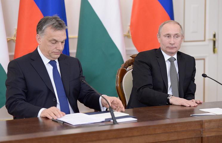 Hungarian Prime Minister Viktor Orban (L) and Russian President Vladimir Putin (R)