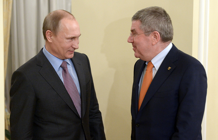 Russian President Vladimir Putin and President of the International Olympic Committee Thomas Bach