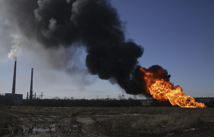 Explosion is seen from the shelled gas pipe near the power station, not far from Debaltsevo, Ukraine