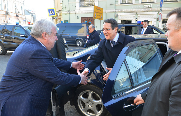 TASS first deputy general director Mikhail Gusman (left) greets the President of Cyprus Nicos Anastasiades (right)