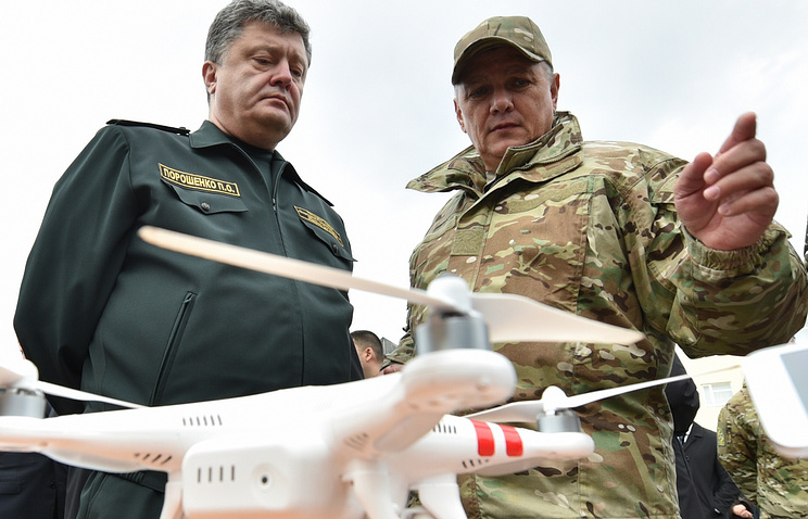 An unmanned aeral vehicle is shown to Ukrainian President Petro Poroshenko (left)