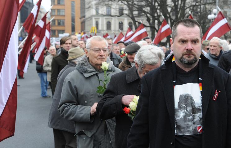 Latvian Waffen SS legion veterans march