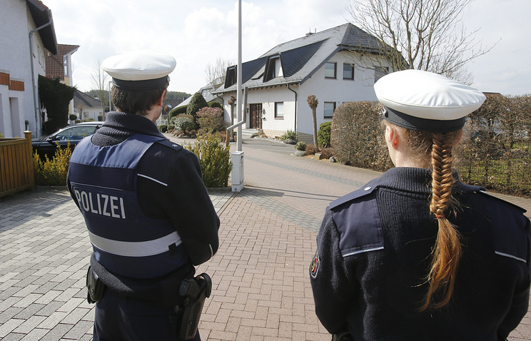Police in front of the house where Andreas Lubitz lived in Montabaur, Germany