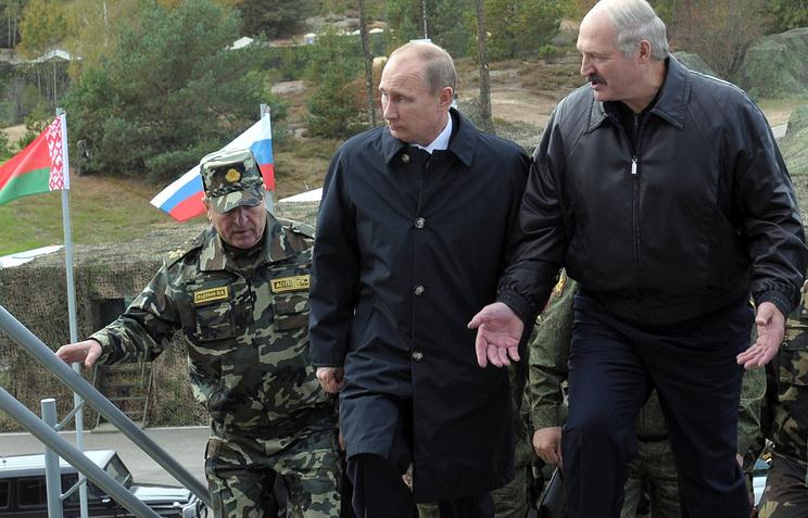 Russian President Vladimir Putin and Belarusian President Alexander Lukashenko during joint Russia-Belarus military drills in 2013