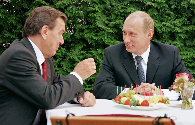 Gerhard Schroeder (left), Vladimir Putin