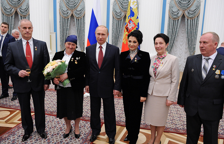 """Vladimir Putin with the holders of the honorary title """"Hero of Labour of the Russian Federation"""""""