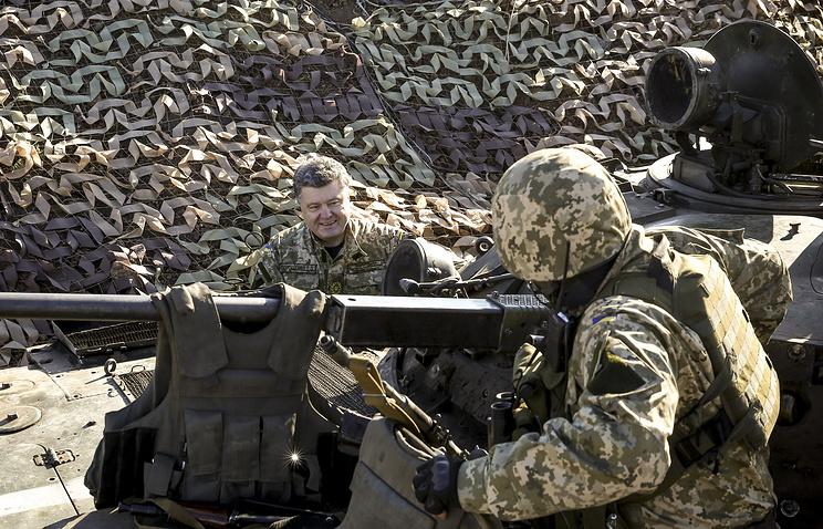 Petro Potoshenko (left) seen in Ukraine's Donetsk region in October 2014