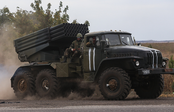 Ukrainian serviceman riding on a surface-to-surface missile complex Grad