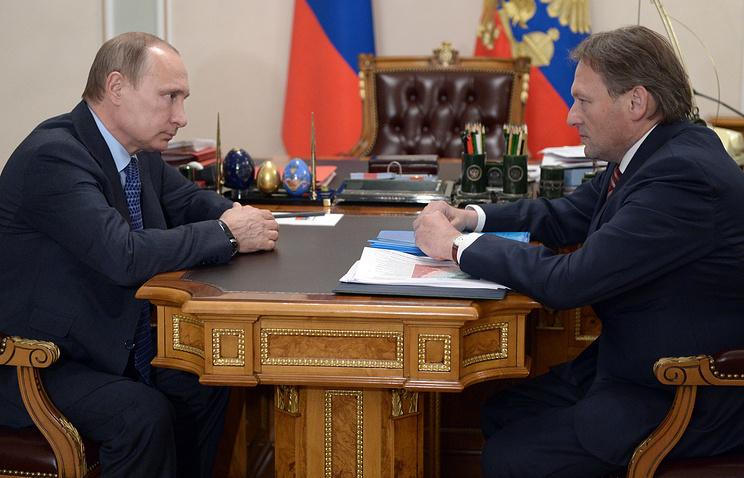Russian President Vladimir Putin and  Business Ombudsman Boris Titov