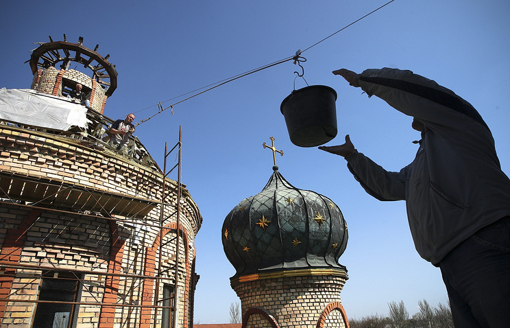 Local citizens repair a church in war-torn east Ukraine