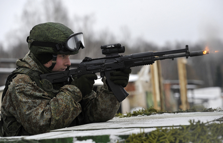 Soldier with Kalashnikov AK-74M rifle