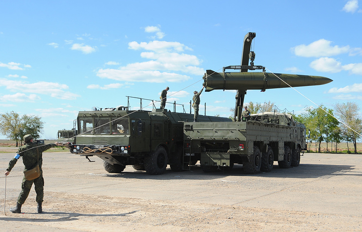 A rocket being loaded into an Iskander-M missile launcher