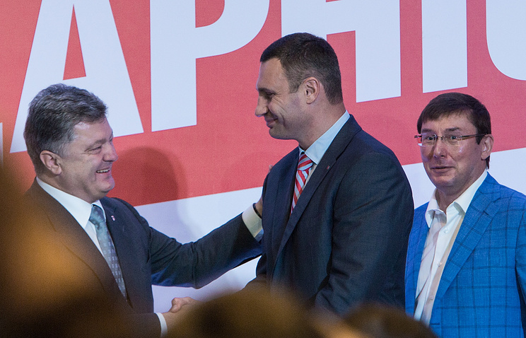 Ukraine's President Petro Poroshenko, Kiev Mayor and UDAR political party leader Vitali Klitschko and Yuriy Lutsenko, leader of the Petro Poroshenko Bloc faction
