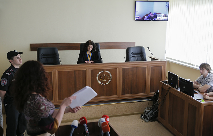 Trial in the Shevchenko district court in Kiev as a TV screen shows Yevgeny Yerofeyev