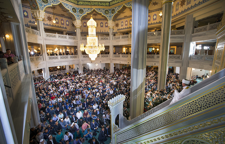 Muslims praying inside the newly restored Moscow Cathedral Mosque during celebrations of Eid al-Adha