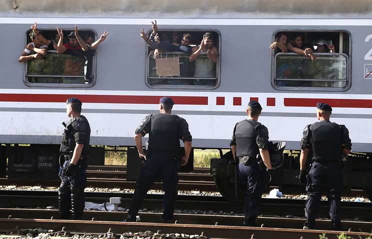 Migrants waving from a train in Croatia