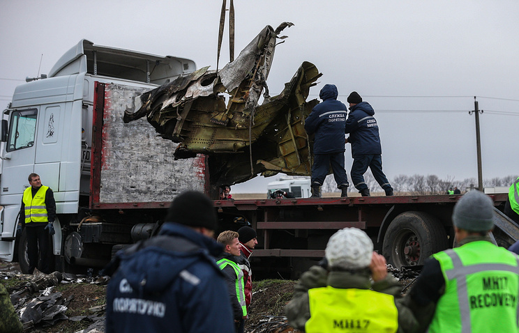 NOVEMBER 16, 2014. Dutch investigators watch the debri of the Malaysia Airlines Boeing 777 which crashed on 17 July 2014 near the village of Grabovo being loaded onto trucks to be sent to the Netherlands for investigation.