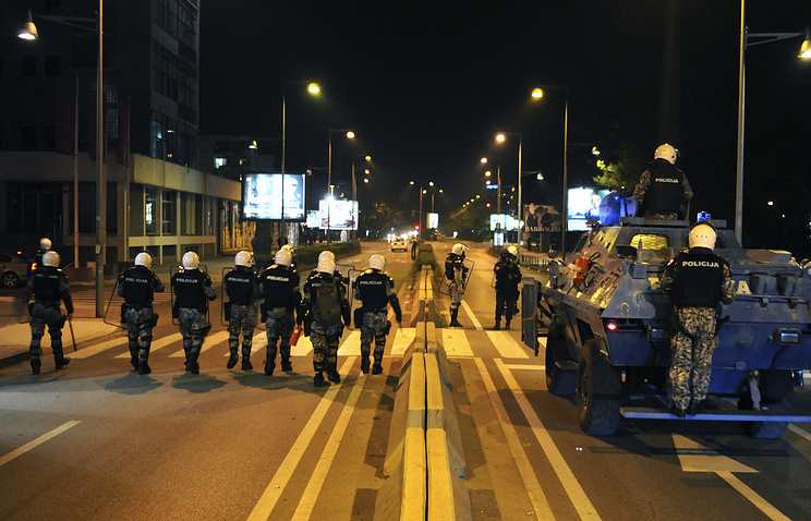 Montenegrin riot police officers seen during clashes with anti-government protesters in Podgorica
