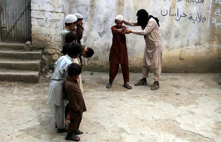 Islamic State militant with children of other mlitants in Kunar province, Afghanistan