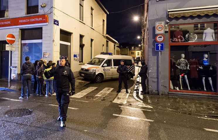 Police on the street in Molenbeek neighborhood, Brussels