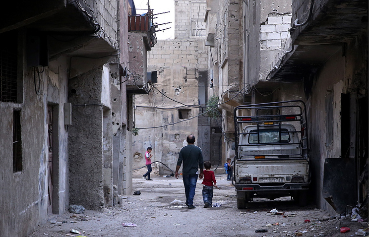 Local residents in the Syrian capital, Damascus