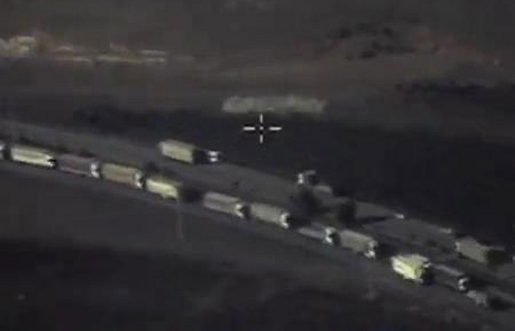 Trucks crossing the Syria-Turkey border at the Reyhanli crossing point