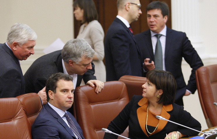 Ukraine's economic development and trade minister Aivaras Abromavicius and finance minister Natalie Jaresko (L-R front) look on at the first session of Ukraine's newly formed Cabinet of Minister in December 2014