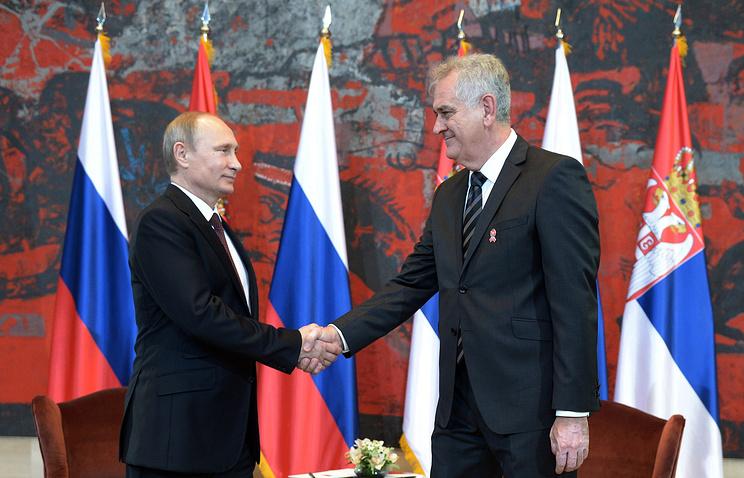 Russia's President Vladimir Putin and Serbia's President Tomislav Nikolic