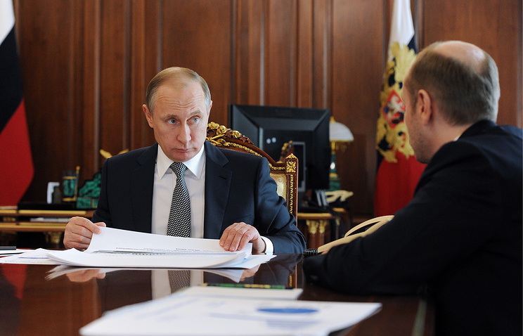 Russian President Vladimir Putin and Russia's Far East Development Minister Alexander Galushka
