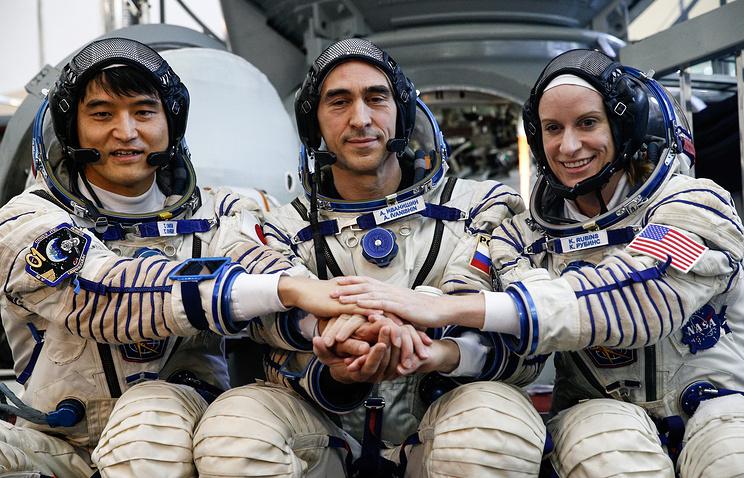 Takuya Onishi,  Anatoly Ivanishin and Kathleen Rubins
