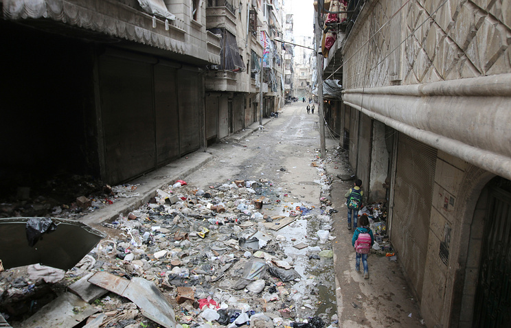 Children walking down a street in Aleppo, Syria