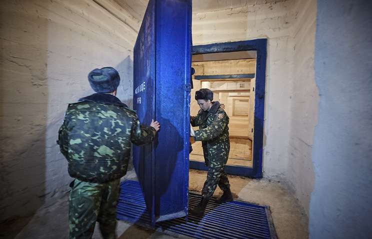 Prison workers inspects a bombshelter for inmates in the village of Podvorki, near the eastern Ukrainian city of Kharkiv