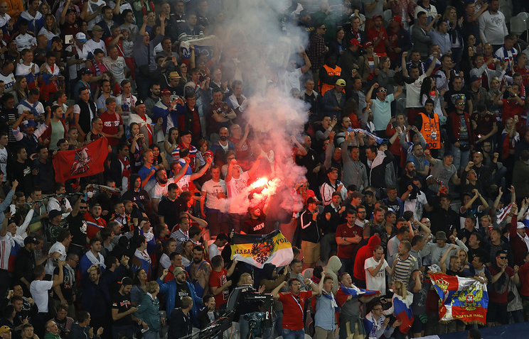 Russian fans celebrating after their team scored a goal during the Euro 2016 soccer match between Russia and Slovakia