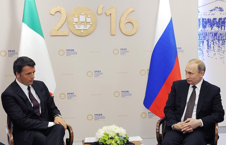 Russian President Vladimir Putin and Italy's Prime Minister Matteo Renzi