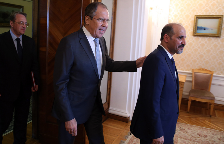 Russian Foreign Minister Sergey Lavrov and Syria's Tomorrow opposition group leader Ahmad al-Jarba