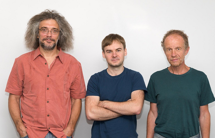 Sergey Shmakov (in the middle) and his supervisors Konstantin Severinov (left) and Eugene Koonin (right)
