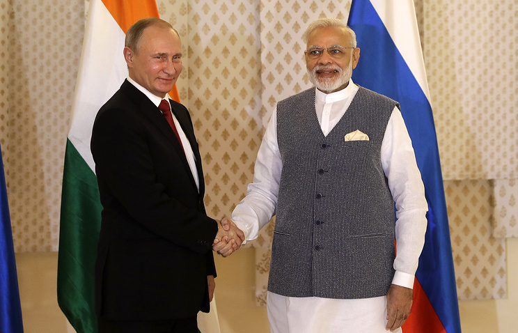 Russian President Vladimir Putin and Indian Prime Minister Narendra Modi