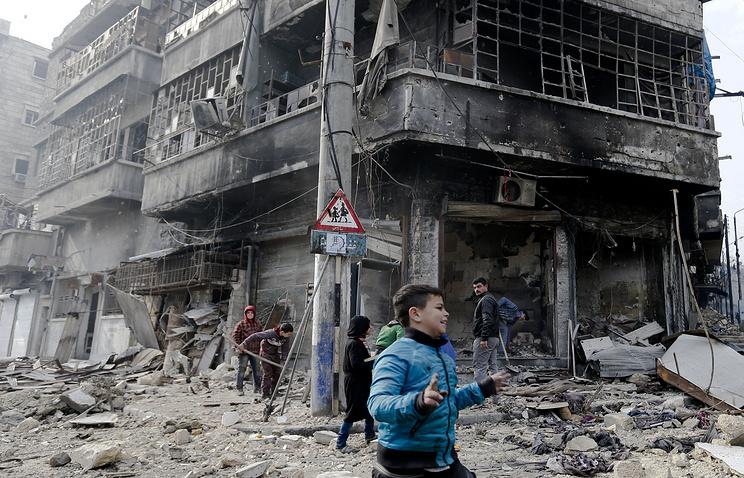 Syrian children in Bustan al-Qasr neighborhood in eastern Aleppo