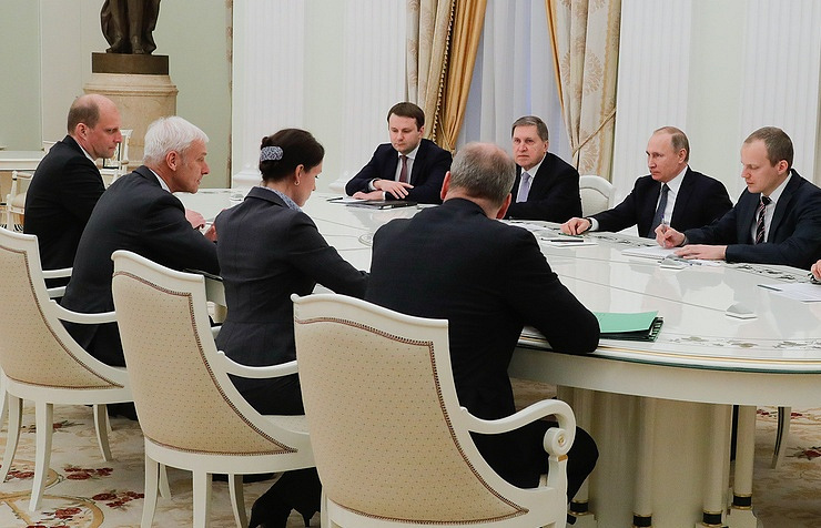 CEO of Volkswagen Group Matthias Muller and Russian President Vladimir Putin during the meeting in Kremlin on February 8