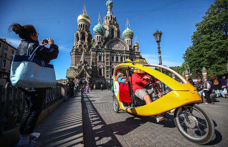 Tourists at the Church of the Savior on the Blood in Saint Petersburg