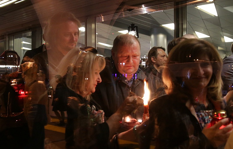 Worshippers meet the Holy Fire at Moscow's Vnukovo airport
