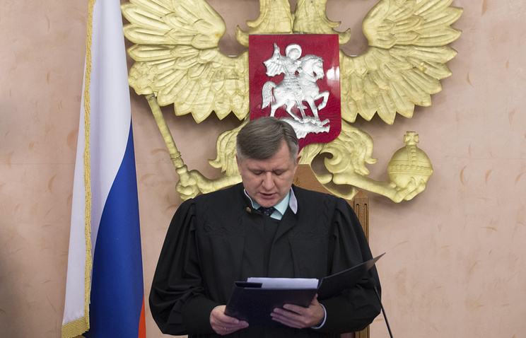 Russia's Supreme Court judge Yuri Ivanenko reads the decision to brand the Jehovah's Witnesses an extremist organization in Russia