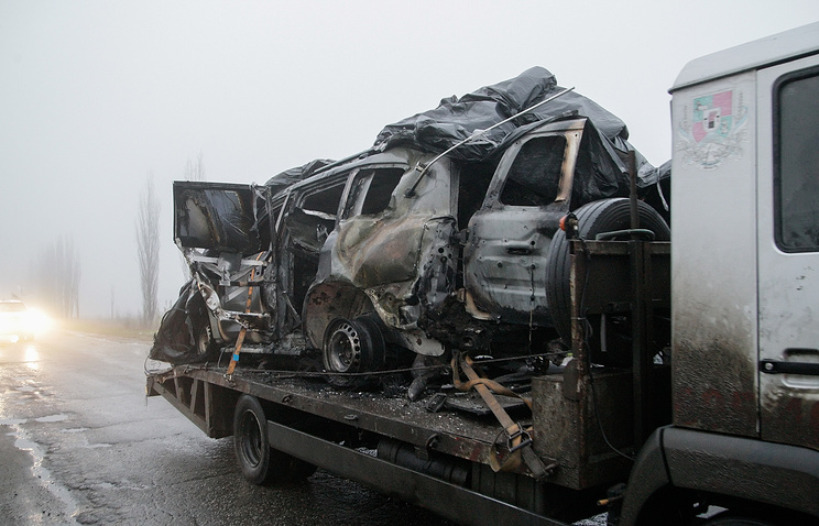 A tow truck moves the OSCE car, damaged in result of explosion not far of the Pryshyb village, Luhansk area