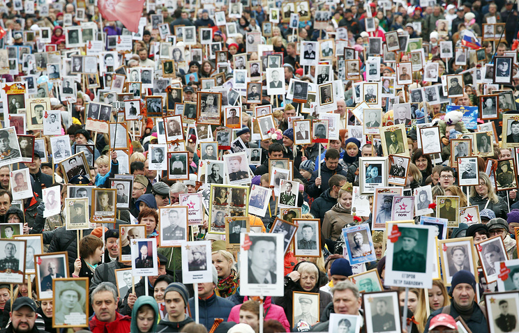 People carry portraits of their relatives who fought in World War II during an Immortal Regiment march