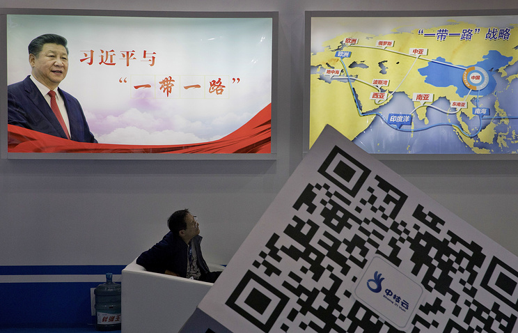 """A portrait of Chinese President Xi Jinping with the words """"Xi Jinping and One Belt One Road"""" in Beijing"""