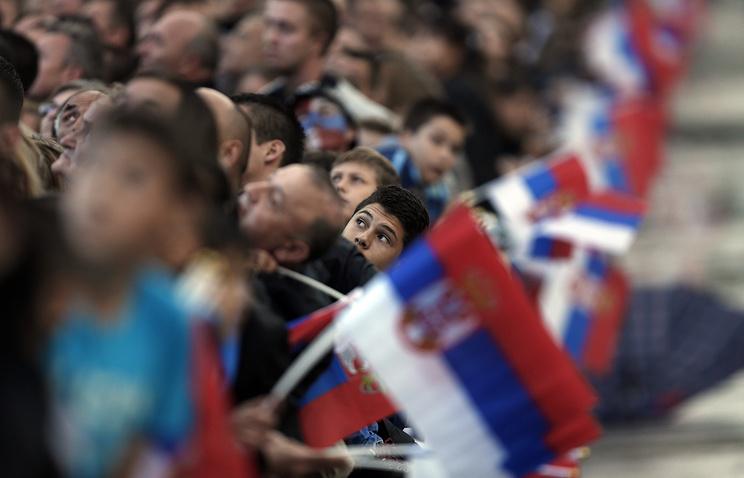 People waving Russian and Serbian flags in Belgrade, Serbia