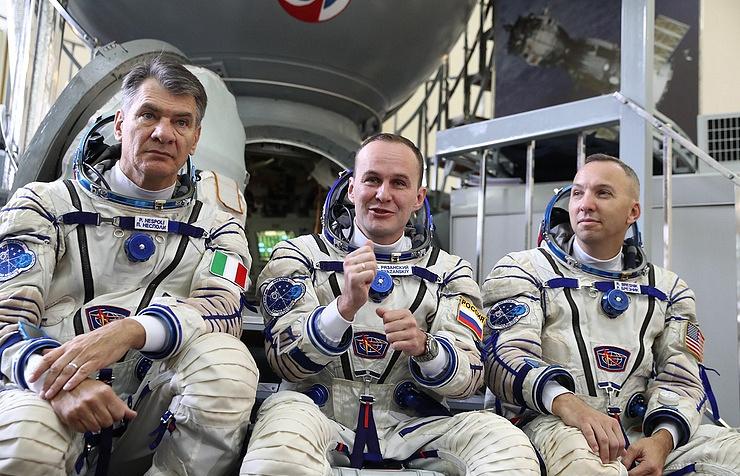 ESA astronaut Paolo Nespoli, Russian cosmonaut Sergey Ryazansky and NASA astronaut Randolph Bresnik near the Soyuz MS-05 spacecraft