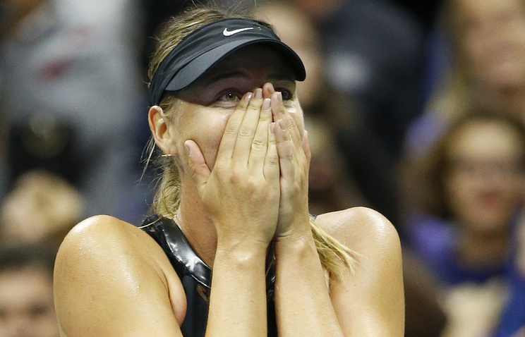 Maria Sharapova reacts after defeating Simona Halep of Romania