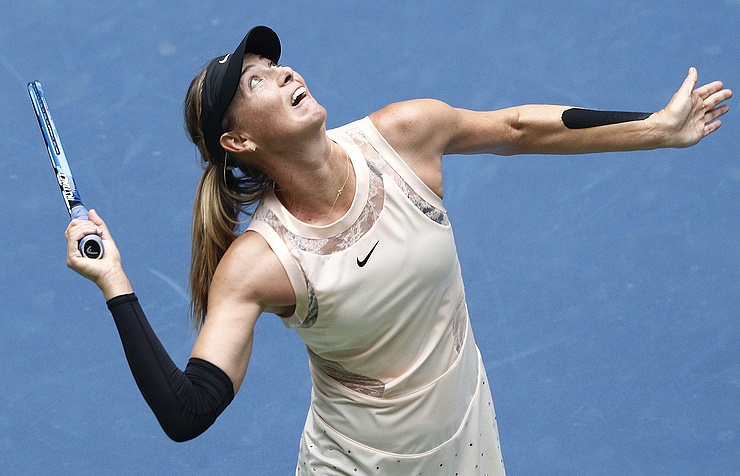 US Open: Sharapova, Venus in action on soggy Sunday